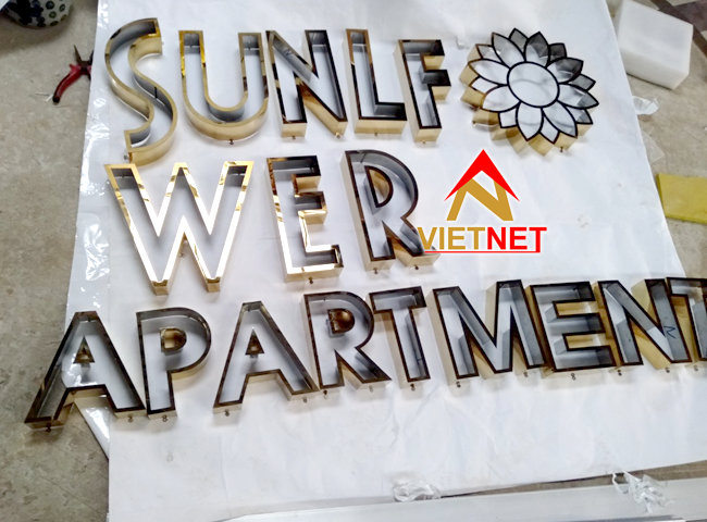 gia cong chu noi inox vang apartment sunflower